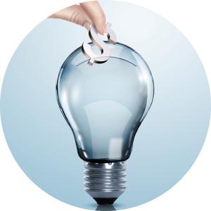 01AS7EK2 - Hand and money inside an electric light bulb